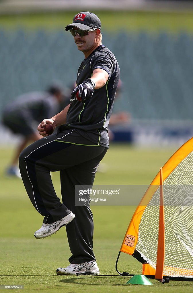 David Warner prepares to throw the ball during an Australian training session at Adelaide Oval on November 20, 2012 in Adelaide, Australia.
