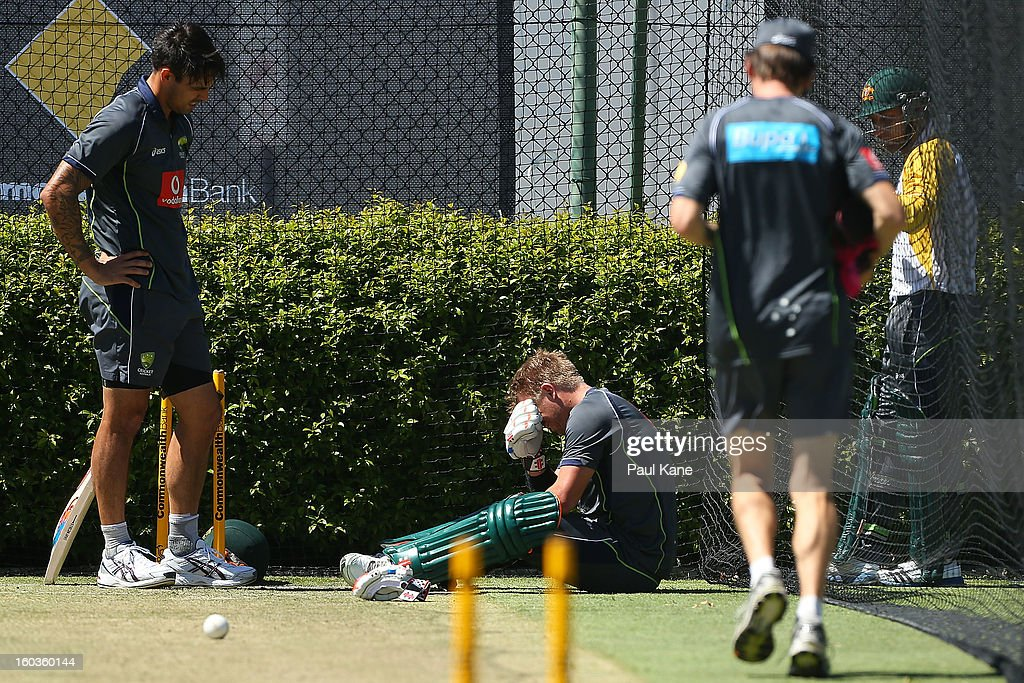 David Warner reacts after being struck on the left hand by Mitchell Johnson during an Australian One Day International training session at WACA on January 30, 2013 in Perth, Australia.