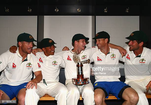 David Warner Usman Khawaja Steve Smith Adam Voges and Joe Burns of Australia celebrate with the TransTasman Trophy in the change rooms after day five...