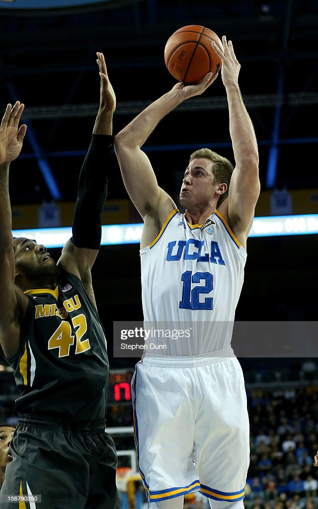 David Wear Wear #12 of the UCLA Bruins shoots over Alex Oriakhi #24 of the Missouri Tigers at Pauley Pavilion on December 28, 2012 in Los Angeles, California. UCLA won 97-94 in overtime.