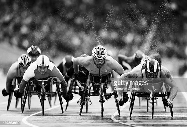 David Weir of England Kurt Fearnley of Australia and Alex Dupont of Canada competes in the Men's T54 1500 metres final at Hampden Park during day...