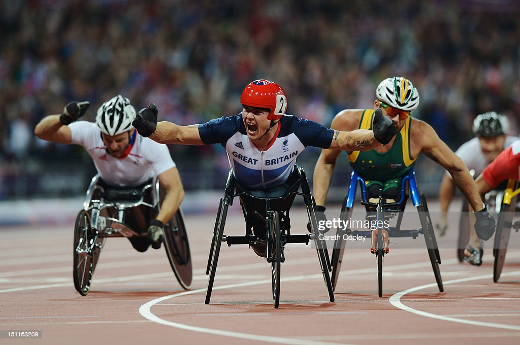 David Weir of Great Britain celebrates as he wins gold ahead of silver medallist Kurt Fearnley of Australia (R) and bronze medallist Julien Casoli of France (L) in the Men's 5000m - T54 Final on day 4 of the London 2012 Paralympic Games at Olympic Stadium on September 2, 2012 in London, England.