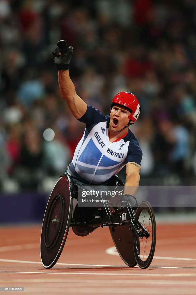 David Weir of Great Britain celebrates as he wins gold in the Men's 5000m - T54 Final on day 4 of the London 2012 Paralympic Games at Olympic Stadium on September 2, 2012 in London, England.