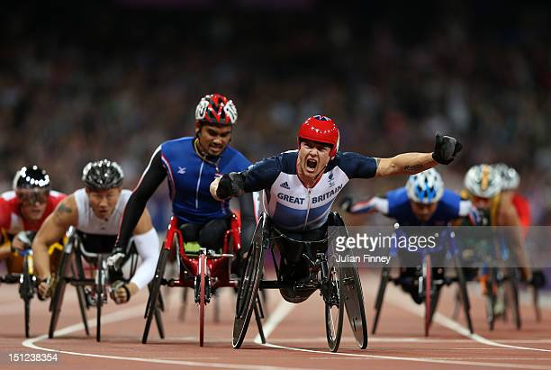 LONDON ENGLAND SEPTEMBER David Weir of Great Britain crosses the line to win gold in the Men's 1500m T54 Final on day 6 of the London 2012 Paralympic...