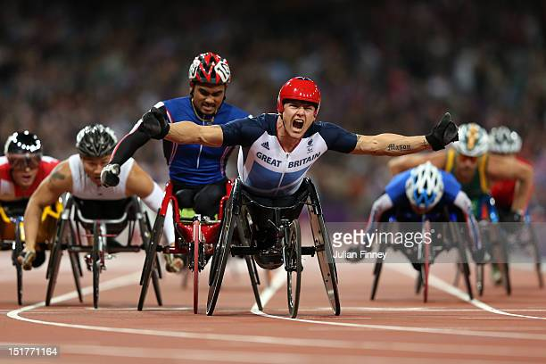 David Weir of Great Britain crosses the line to win gold in the Men's 1500m T54 Final on day 6 of the London 2012 Paralympic Games at Olympic Stadium...