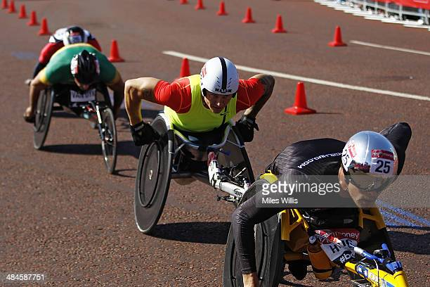 David Weir of Great Britain follows Marcel Hug of Switzerland as they pass Buckingham Palace in the Wheelchair race during the Virgin London Marathon...