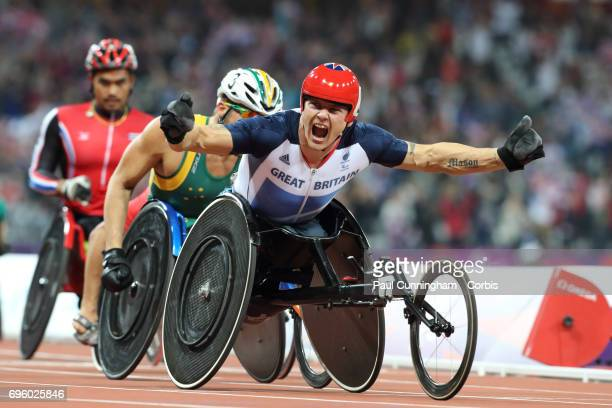 David Weir of Great Britain is jubilant as he crosses the finish line first to win the Gold Medal in the Men's 5000m T54 Final on day 4 of the London...