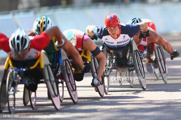 David Weir of Great Britain keeps a close eye on the leading pack on his way to winning his fourth gold medal of the Paralympic Games in the Men's...