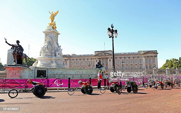 David Weir of Great Britain makes his way past Buckingham Palace during the T54 Men's Marathon on day 11 of the London 2012 Paralympic Games on The...
