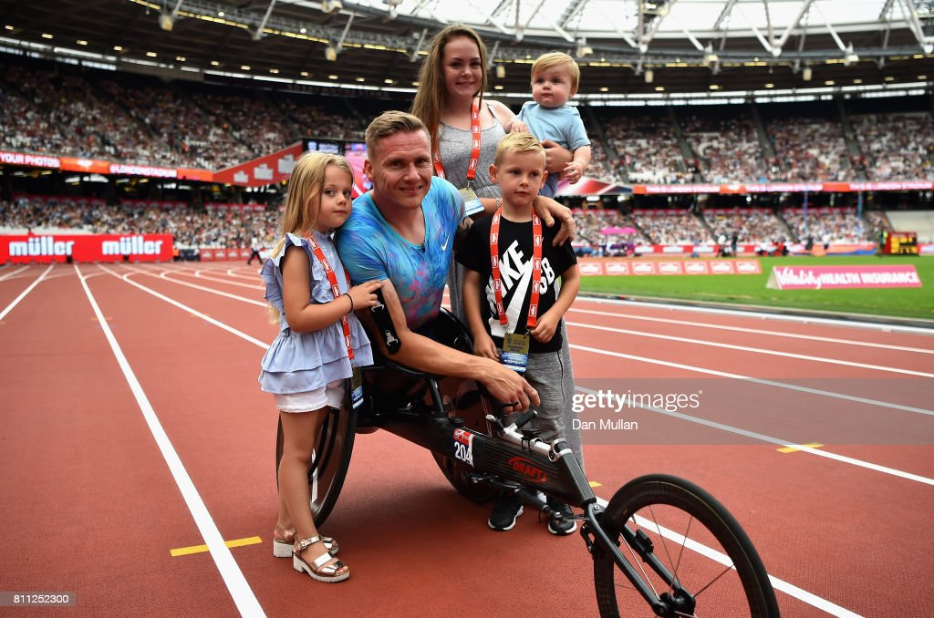David Weir of Great Britain poses for a photo with his family after winning the mens T54 800m race which will be last event before he retires during the Muller Anniversary Games at London Stadium on July 9, 2017 in London, England.