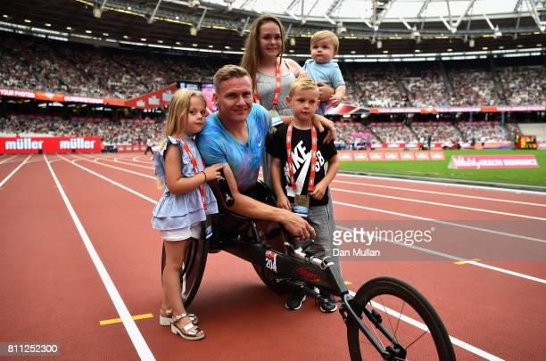 David Weir of Great Britain poses for a photo with his family after winning the mens T54 800m race which will be last event before he retires during...