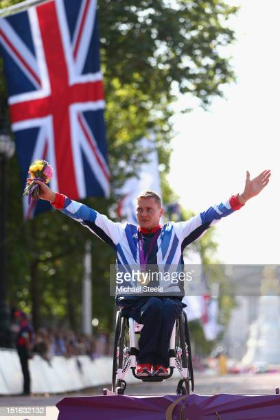 David Weir of Great Britain poses with his fourth gold medal of the Paralympic Games after victory in the Men's T54 Marathon on day 11 of the London...