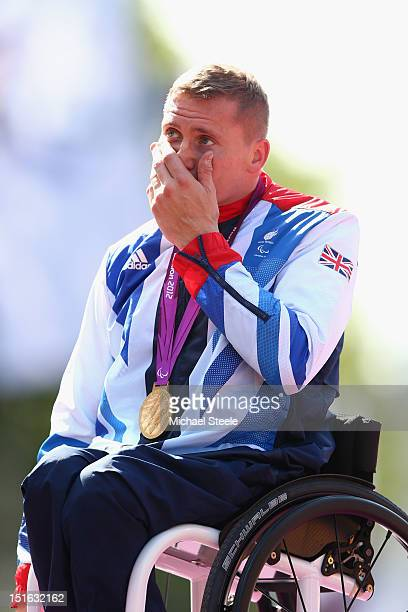 David Weir of Great Britain struggles to hold his emotions after being presented with his fourth gold medal of the Paralympic Games after victory in...