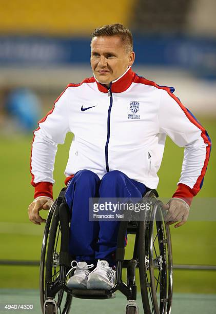 David Weir of Great Britain waits for his medal after the men's 1500m T54 final during the Evening Session on Day Three of the IPC Athletics World...