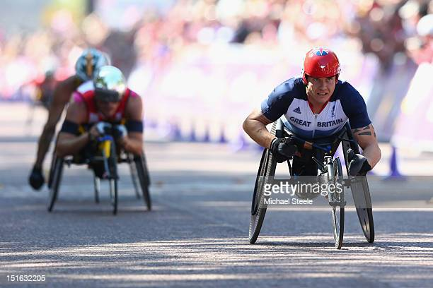 David Weir of Great Britain wins his fourth gold medal of the Paralympic Games from Marcel Hug of Switzerland and Kurt Fearnley of Australia in the...