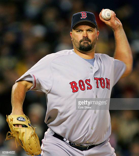 David Wells of the Boston Red Sox throws a pick to first base against the New York Yankees during the Yankee's home opener at Yankee Stadium on April...