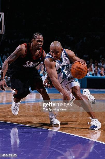 David Wesley of the Charlotte Hornets drives to the basket past Allen Iverson of the Philadelphia 76ers during the game on May 4 1999 at Charlotte...