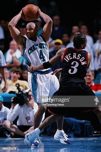David Wesley of the Charlotte Hornets looks to pass over Allen Iverson of the Philadelphia 76ers during the game on May 4 1999 at Charlotte Coliseum...