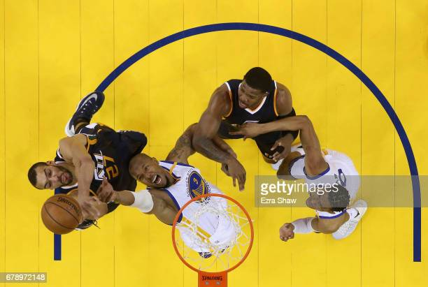 David West and Patrick McCaw of the Golden State Warriors go for the rebound against Rudy Gobert and Joe Johnson of the Utah Jazz during Game Two of...