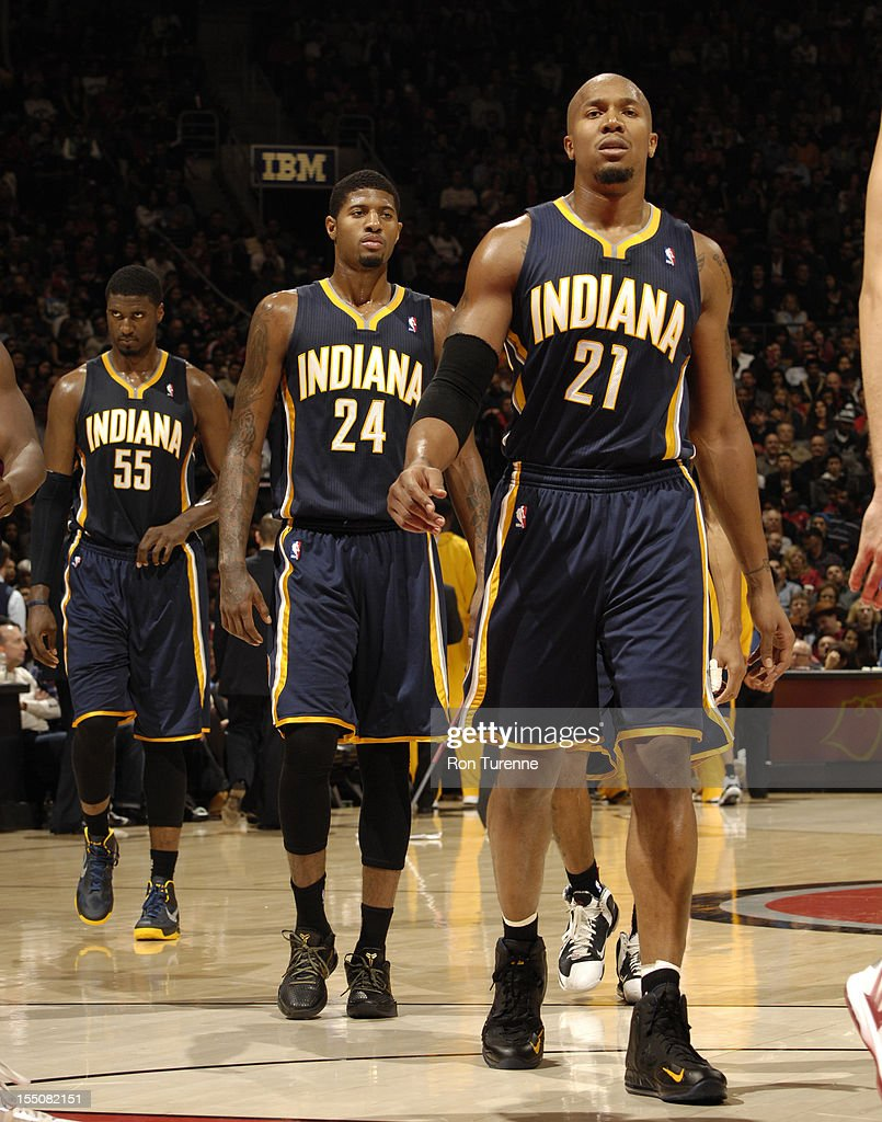 David West #21 and Paul George #24 of the Indiana Pacers walk on the court during the game against the Toronto Raptors on October 31, 2012 at the Air Canada Centre in Toronto, Ontario, Canada.