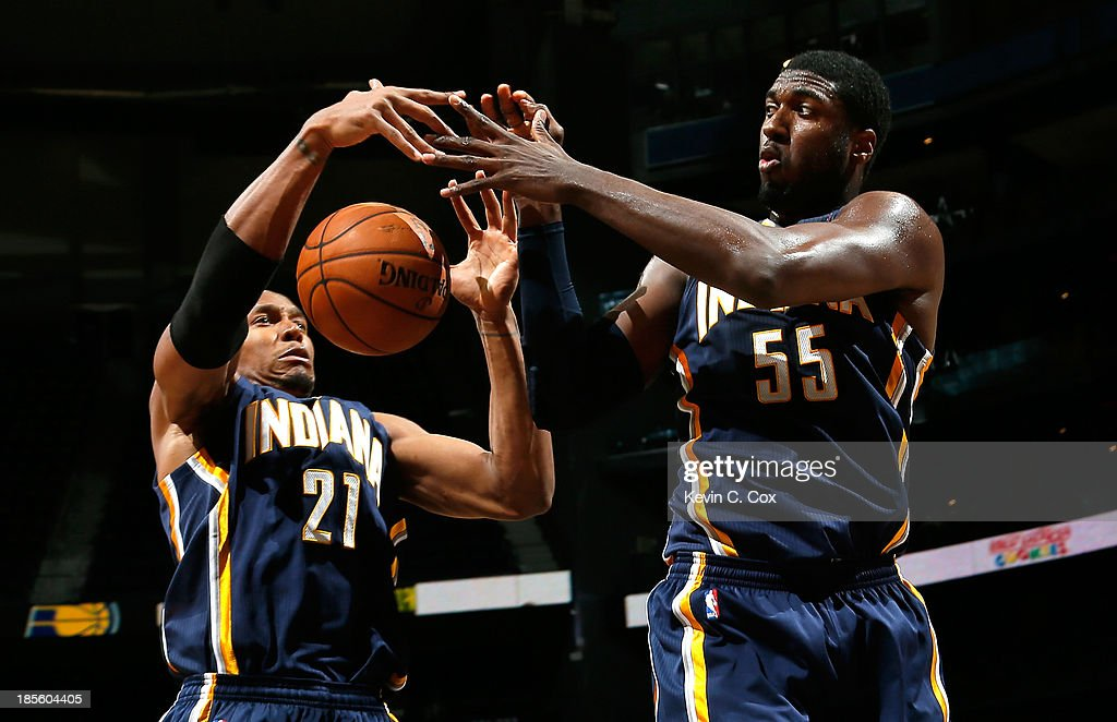 David West #21 and Roy Hibbert #55 of the Indiana Pacers battle for a rebound against the Atlanta Hawks at Philips Arena on October 22, 2013 in Atlanta, Georgia.