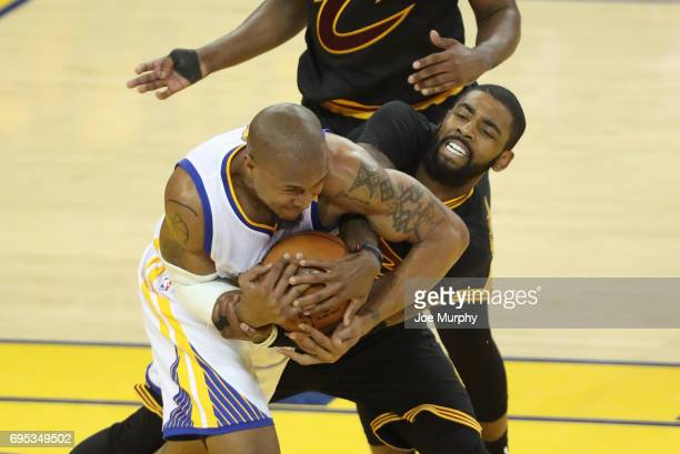 David West of the Golden State Warriors and Kyrie Irving of the Cleveland Cavaliers battle for possession in Game Five of the 2017 NBA Finals on June...