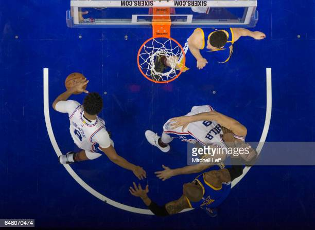 David West of the Golden State Warriors fouls Dario Saric of the Philadelphia 76ers in the fourth quarter at the Wells Fargo Center on February 27...