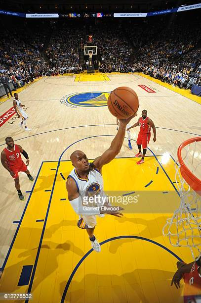 David West of the Golden State Warriors goes to the basket against the Los Angeles Clippers during a preseason game on October 4 2016 at Oracle Arena...