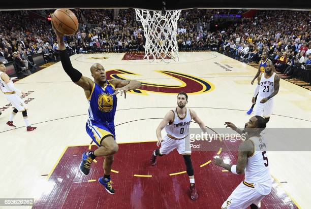 David West of the Golden State Warriors goes up with the ball against Kevin Love and JR Smith of the Cleveland Cavaliers in the second half in Game 3...