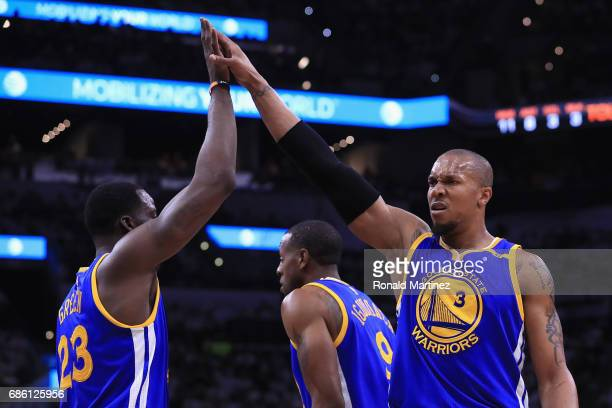 David West of the Golden State Warriors high fives Draymond Green in the first half against the San Antonio Spurs during Game Three of the 2017 NBA...