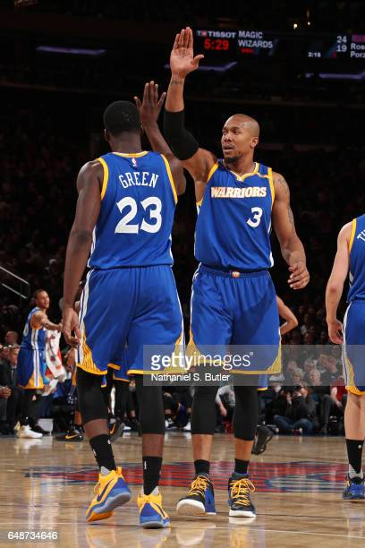 David West of the Golden State Warriors high fives Draymond Green during the game against the New York Knicks on March 5 2017 at Madison Square...