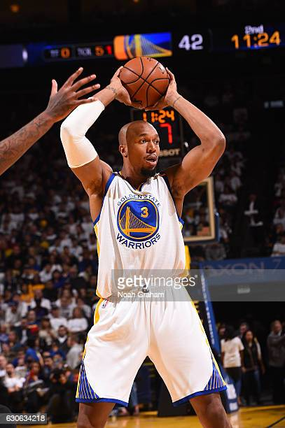 David West of the Golden State Warriors looks to pass the ball during a game against the Toronto Raptors on December 28 2016 at ORACLE Arena in...