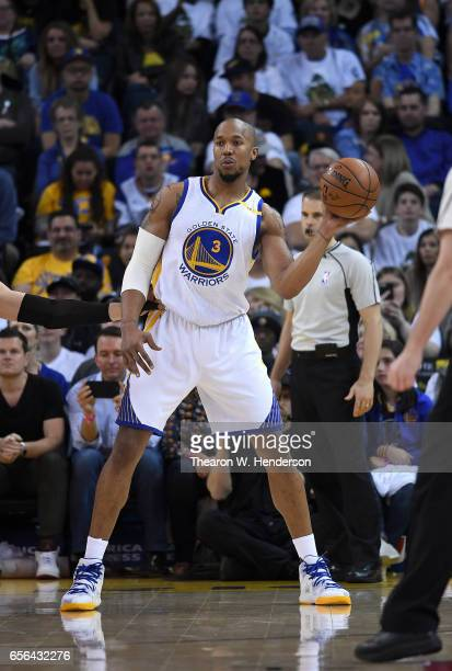 David West of the Golden State Warriors looks to pass the ball against the Orlando Magic during an NBA basketball game at ORACLE Arena on March 16...
