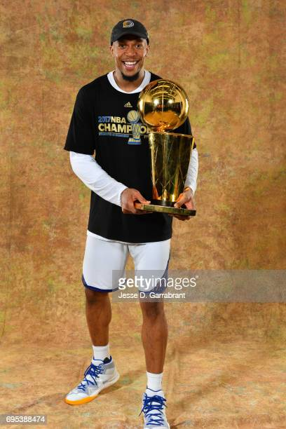 David West of the Golden State Warriors poses for a portrait with the Larry O'Brien Trophy after defeating the Cleveland Cavaliers in Game Five of...