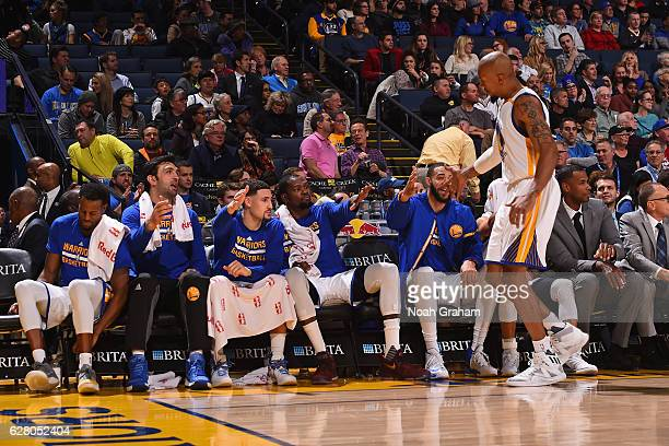 David West of the Golden State Warriors shakes hands with the bench during the game against the Indiana Pacers on December 5 2016 at ORACLE Arena in...