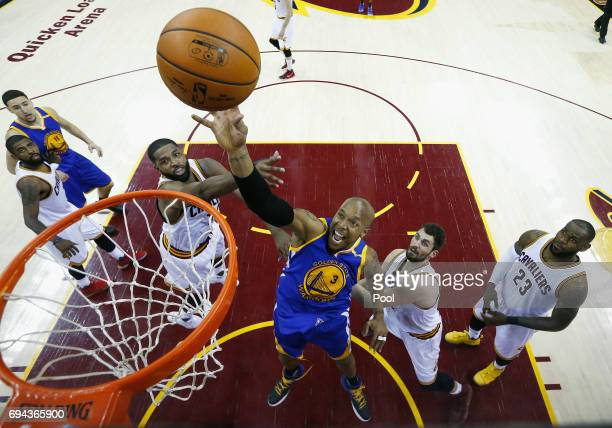 David West of the Golden State Warriors shoots in the second half against Tristan Thompson and Kevin Love of the Cleveland Cavaliers in Game 4 of the...