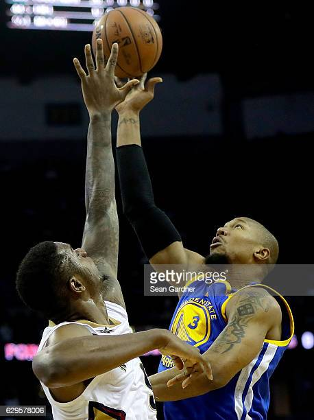 David West of the Golden State Warriors shoots over Terrence Jones of the New Orleans Pelicans during the second half at the Smoothie King Center on...