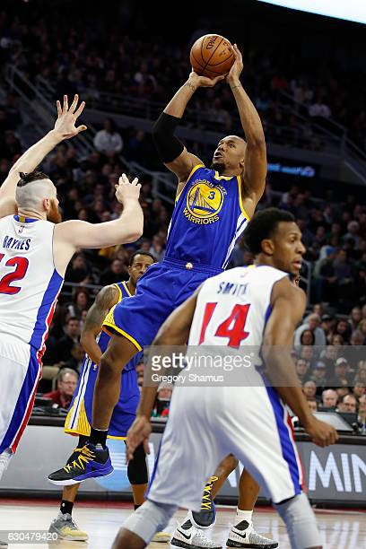 David West of the Golden State Warriors takes a shot over Aron Baynes of the Detroit Pistons during the first half at the Palace of Auburn Hills on...