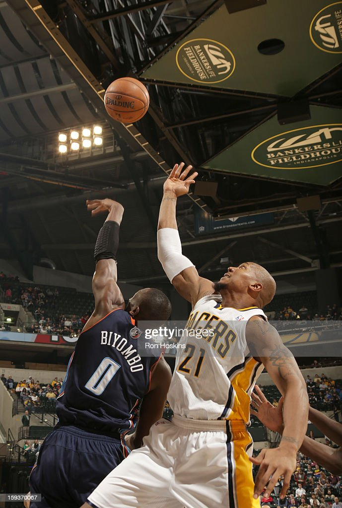 David West #21 of the Indiana Pacers and Bismack Biyombo #0 of the Charlotte Bobcats reach for the ball during the game between the Indiana Pacers and the Charlotte Bobcats on January 12, 2013 at Bankers Life Fieldhouse in Indianapolis, Indiana.