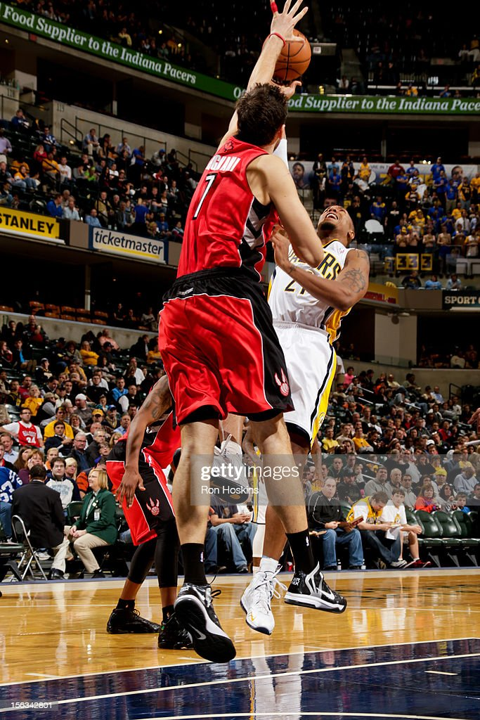 David West #21 of the Indiana Pacers attempst a shot against Andrea Bargnani #7 of the Toronto Raptors on November 13, 2012 at Bankers Life Fieldhouse in Indianapolis, Indiana.