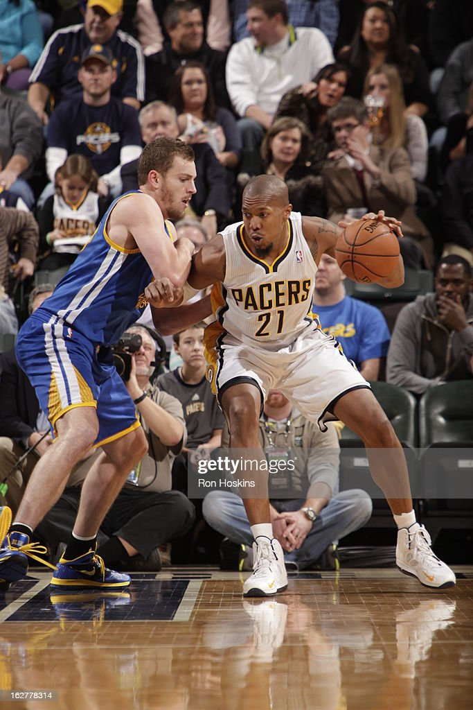 David West #21 of the Indiana Pacers back up to the hoop against the Golden State Warriors on February 26, 2013 at Bankers Life Fieldhouse in Indianapolis, Indiana.