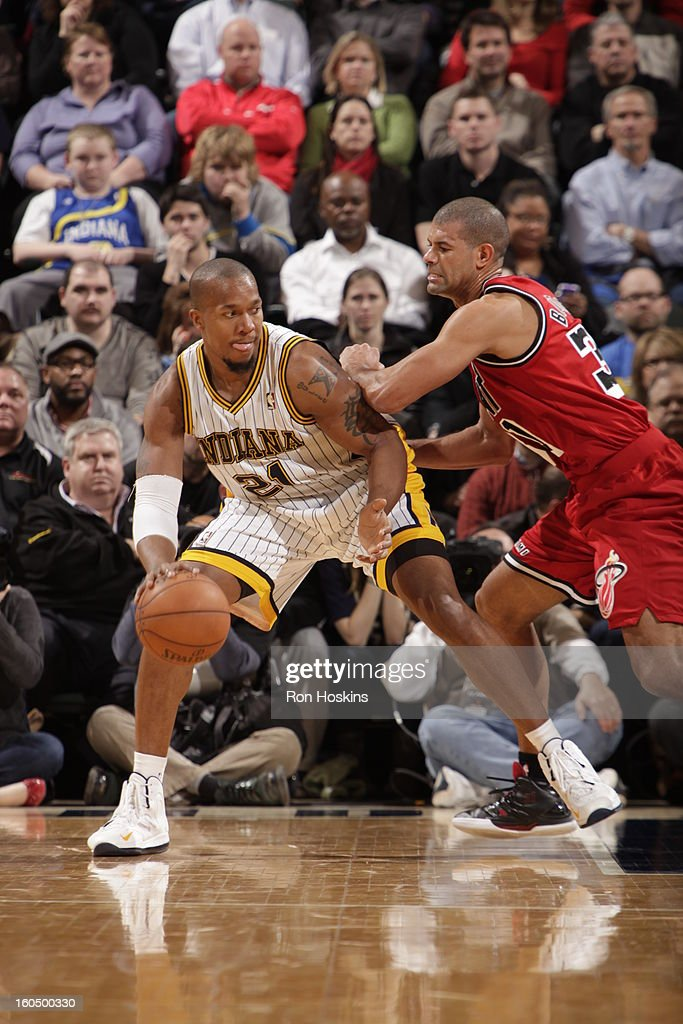 David West #21 of the Indiana Pacers backs up to the basket against <a gi-track='captionPersonalityLinkClicked' href=/galleries/search?phrase=Shane+Battier&family=editorial&specificpeople=201814 ng-click='$event.stopPropagation()'>Shane Battier</a> #31 of the Miami Heat on February 1, 2013 at Bankers Life Fieldhouse in Indianapolis, Indiana.