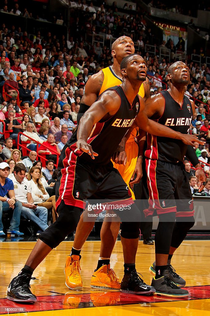 David West #21 of the Indiana Pacers battles for rebound position against Chris Bosh #1 and Dwyane Wade #3 of the Miami Heat on March 10, 2013 at American Airlines Arena in Miami, Florida.
