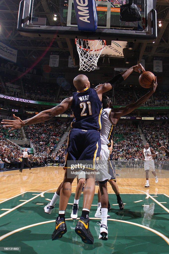 David West #21 of the Indiana Pacers blocks DeMarre Carroll #3 of the Utah Jazz at Energy Solutions Arena on January 26, 2013 in Salt Lake City, Utah.