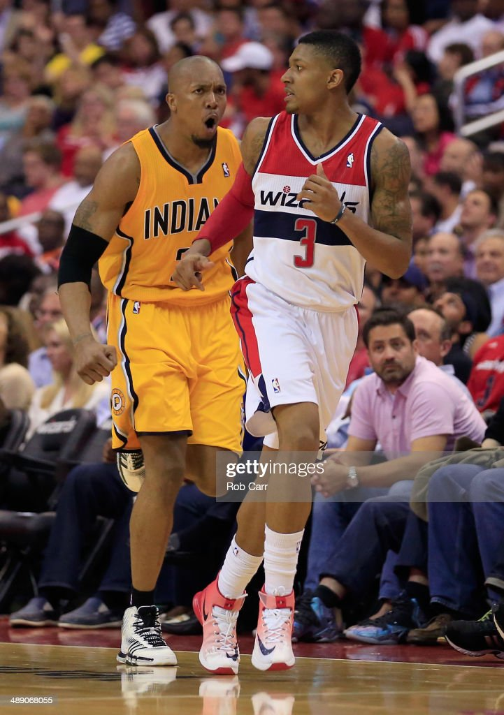 David West #21 of the Indiana Pacers celebrates after scoring a three pointer in front of <a gi-track='captionPersonalityLinkClicked' href=/galleries/search?phrase=Bradley+Beal&family=editorial&specificpeople=7640439 ng-click='$event.stopPropagation()'>Bradley Beal</a> #3 of the Washington Wizards during the second half of the Eastern Conference Semifinals during the 2014 NBA Playoffs at Verizon Center on May 9, 2014 in Washington, DC. The Pacers won 85-63.