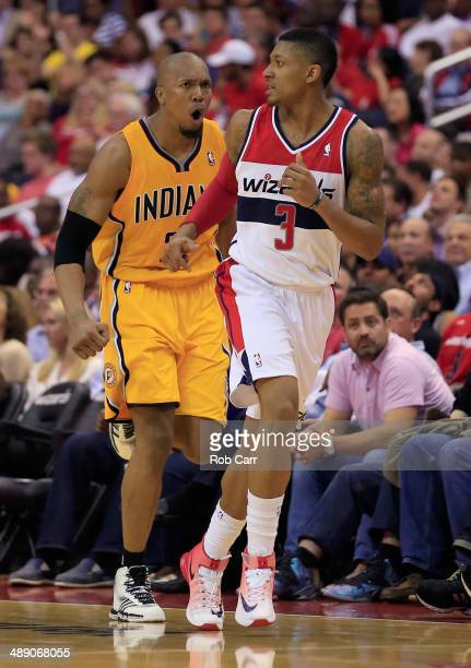 David West of the Indiana Pacers celebrates after scoring a three pointer in front of Bradley Beal of the Washington Wizards during the second half...
