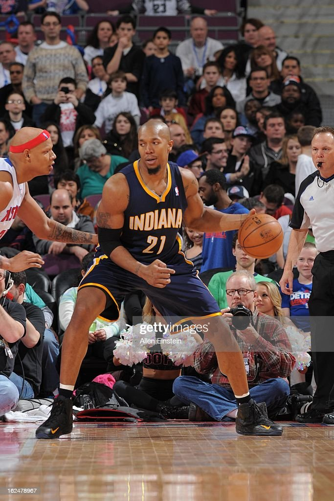 David West #21 of the Indiana Pacers controls the ball against Charlie Villanueva #31 of the Detroit Pistons on February 23, 2013 at The Palace of Auburn Hills in Auburn Hills, Michigan.
