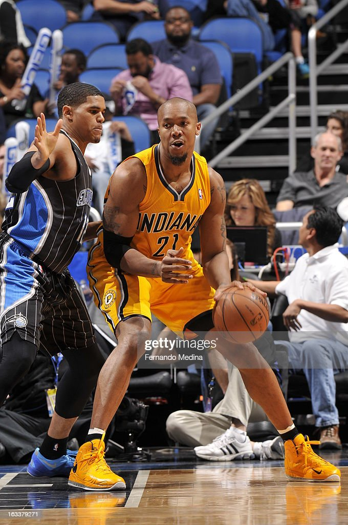 David West #21 of the Indiana Pacers controls the ball against Tobias Harris #12 of the Orlando Magic on March 8, 2013 at Amway Center in Orlando, Florida.