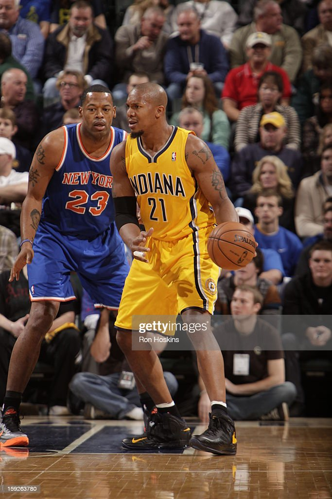 David West #21 of the Indiana Pacers dribbles against Marcus Camby #23 of the New York Knicks on January 10, 2013 at Bankers Life Fieldhouse in Indianapolis, Indiana.