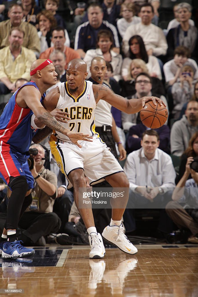 David West #21 of the Indiana Pacers dribbles the ball against Charlie Villanueva #31 of the Detroit Pistons on February 22, 2013 at Bankers Life Fieldhouse in Indianapolis, Indiana.